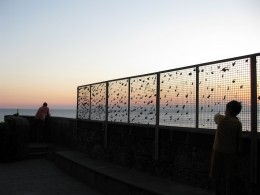 Love padlocks on a fence against the peaceful Cinque Terre sunset!