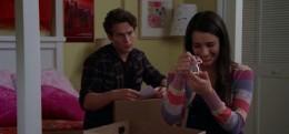 Rachel and Jesse looking through Rachel's baby stuff