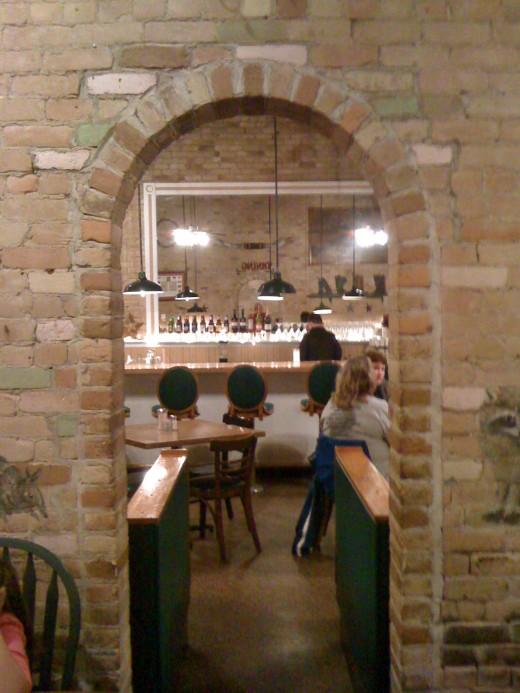 Arched doorways between dining areas.