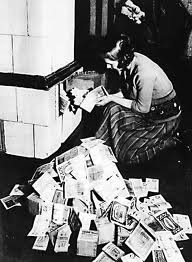 A German woman burns hyper-inflated money in 1931.  Germany not only faced the depression the rest of Europe had, but it also had to pay reparations for WWI.  The money was so worthless it was better to burn it for warmth.