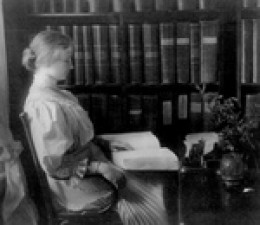 Helen Keller reading by Braille