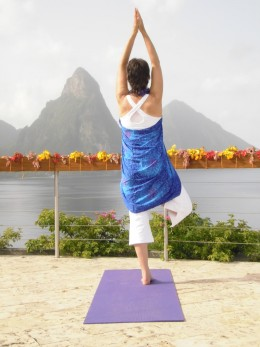 Morning yoga on the Celestial Terrace above the Pitons and Soufriere, St Lucia:  tree posture, sea and mountain