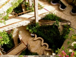 Stairways at Jade Mountain Resort include goldfish ponds and flowering tropical plants at every turn.