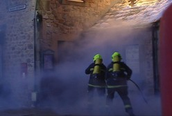 the fire crew desperately try to put out the fire