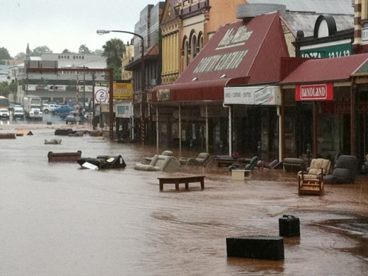 Furniture and debris being washed out onto the streets by flash flooding in Toowoomba.