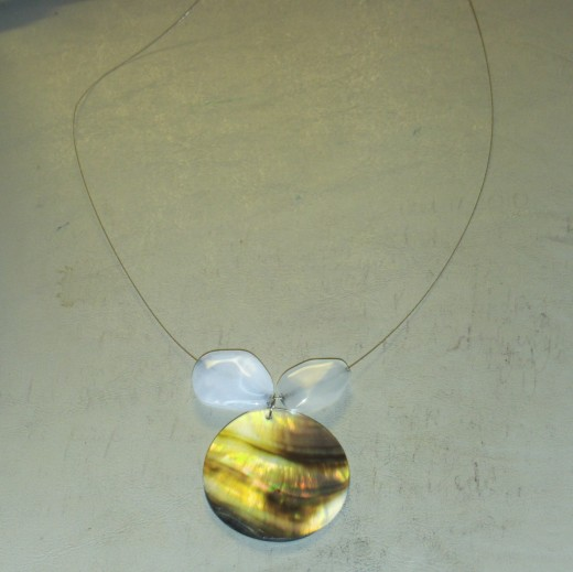 Add a large white acrylic bead on each side of the pendant.