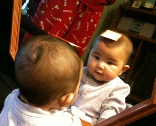 She is unaware that she is looking at herself.
