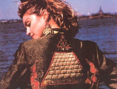 Madonna? Who would've guessed. And what's that symbol on the back of her jacket...