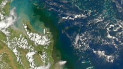 The flood water plume (brown colour), as seen from a satellite, emerging from the mouth of the Fitzroy River (bottom of pic) and spreading north and towards coral reefs, on January 4 2011.