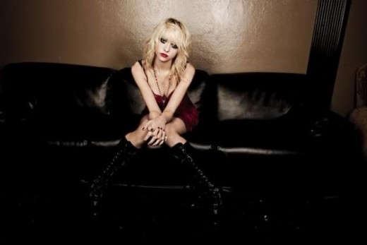 "Beautiful Taylor Momsen posing on a leather couch for a photoshoot for the new album ""Light Me Up"" by her band, The Pretty Reckless"