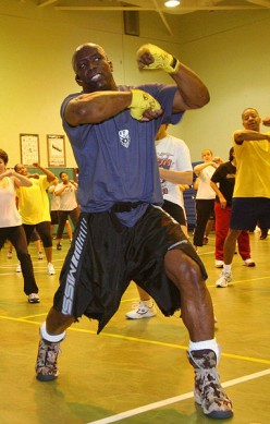 Billy Blanks holds a class for service members and their dependents on his famous roll boxing Tae Bo techniques. Armed Forces Entertainment is sponsoring Blanks tour, which provides him with the opportunity to exercise and motivate