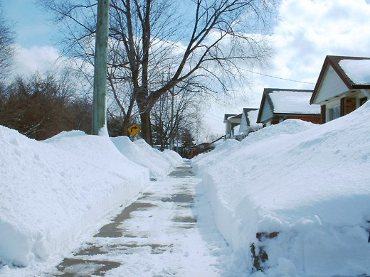 The snow piled high on many a street