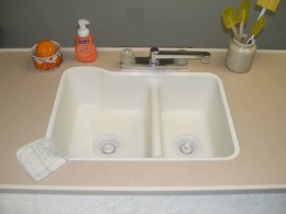 Kitchen double sink is smaller than your normal size home double sink.
