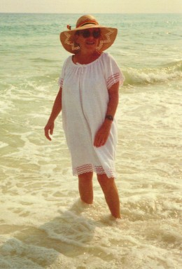 My mother walking in the water at Fort Walton Beach, Florida