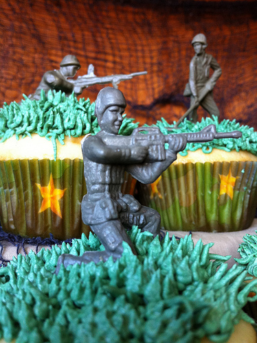 Call of Duty Cupcakes using army men figures and the camouflage baking liners featured on this page.