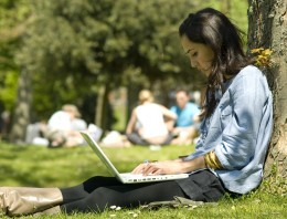 A student on Campus with her Laptop