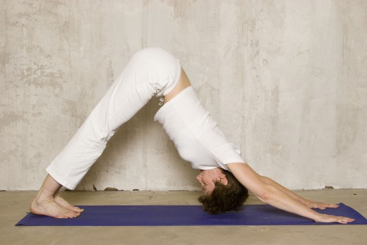 Downward Facing Dog lifts the hips above the heart and flushes toxins from the organs.