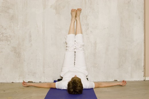 Legs Up the Wall is an easy variation of shoulderstand.  If it is comfortable, elevate the hips on a bolster to create a gentle abdominal inversion, and relax here for five minutes.