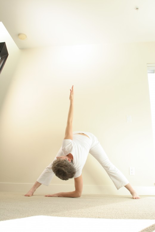 Windmill twists and inverts at the same time, as it tones abdominal muscles and stretches the legs.
