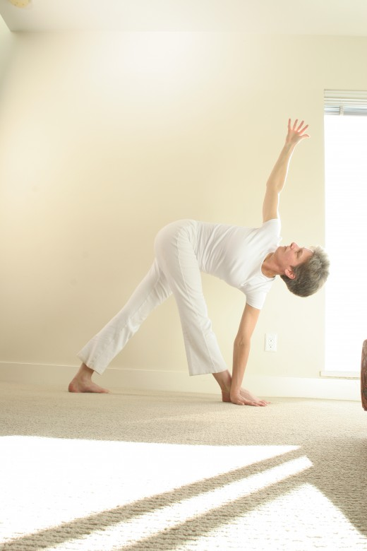 Revolving triangle twists, stretches legs, and develops balance.