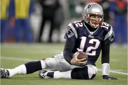 Brady sacked 5 times! (AP Photo/Winslow Townson)