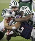 Eric Smith and David Harris tackle  Patriots' BenJarvus Green-Ellis  (AP Photo/Stephan Savoia)