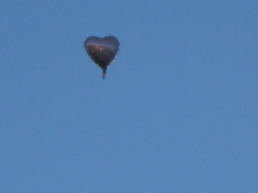 A balloon breaks away and floats towards Heaven