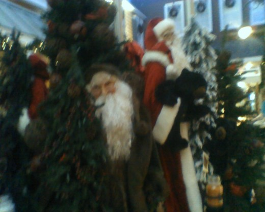 By the entrance, several statues of Father Christmas greet shoppers of all ages.