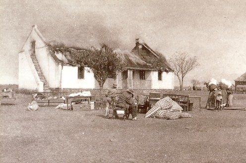 "Boer farmhouse being burnt by the British. Image from ""The Boer War"" by David Smurthwaite (Hamlyn, 1999)"