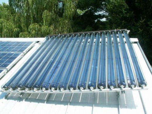Rooftop solar collectors heating hot water.