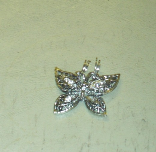 I attached two jump rings so I would be able to slide the broken part of the sparkly butterfly hair clip on the necklace.  The broken hair clip will be the pendant for the necklace.