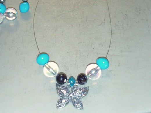 Here I added a large aqua colored bead of the necklace.  These beads are actually vintage.