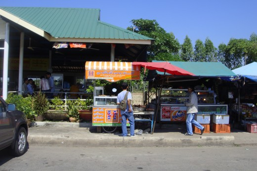 I purchased 4 apples for 40 baht (a little more than a US dollar) on one of my trips.  The picture doesn't show the two monks dressed in typical orange robes that were eating in the open air restaurant area