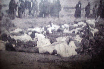 "Bodies of the dead at Bullhoek. From ""Let's Praise"" magazine."