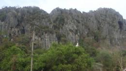 A white budha statue from afar.