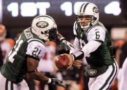 New York Jets Mark Sanchez hands the ball off to LaDainian Tomlinson