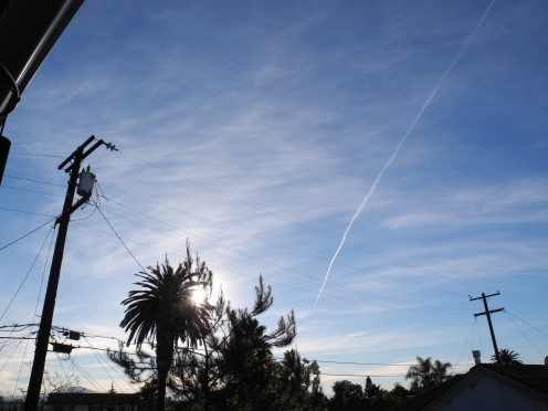 Pencil thin line of initial chemtrail, gradually matures into a huge cloud-like formation.