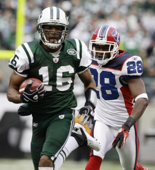 New York Jets' Brad Smith, left, carries the ball for a first down while pursued by Buffalo Bills' Leodis McKelvin during the first quarter of an NFL football game at New Meadowlands Stadium, Sunday, Jan. 2, 2011, in East Rutherford, N.J. (AP Photo/K