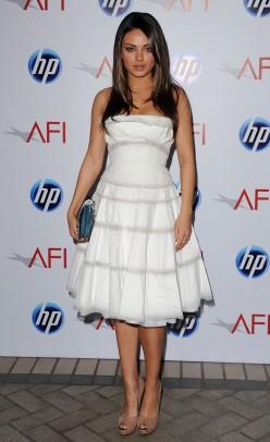 Mila Kunis in white strapless full skirt.