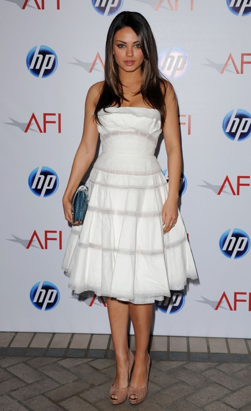 Mila Kunis in white strapless full skirt.