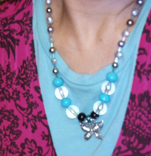 Here is the completed necklace with the broken sparkly clip repurposed as the pendant.