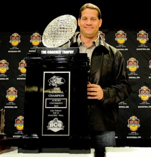 Auburn Head Coach Gene Chizik with the 2011 National Championship Trophy.  The Tigers were denied the opportunity to play for the 2005 National Championship, even though they compiled an undefeated 13-0 season with an SEC Championship that year.