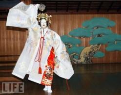 Saraguka Dancer. Face covered by Mask.