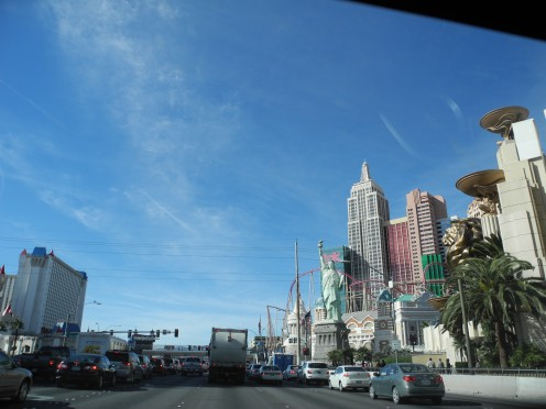 Chemtrail Clouds dispersing to look identical to real clouds-- above the skyline of the Vegas Strip. Notice that these clouds have a consistency and density similar to baking soda... (plus aluminum).