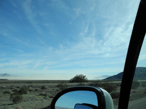 View out my car window, Vegas in my rear view mirror.  Chem Cloud skies... beautiful but highly toxic.
