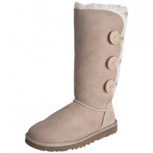 UGG Bailey Button boots shown in sand.