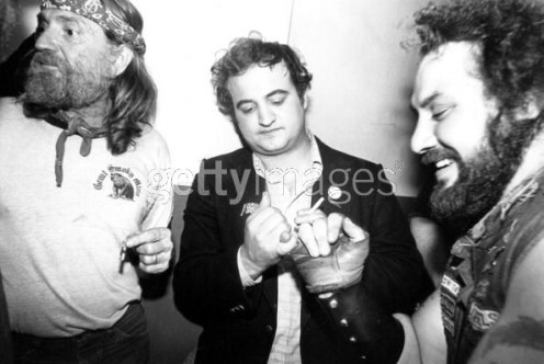 John Belushi sharing a joint with Willie Nelson and pinky promising a HellsAngel.