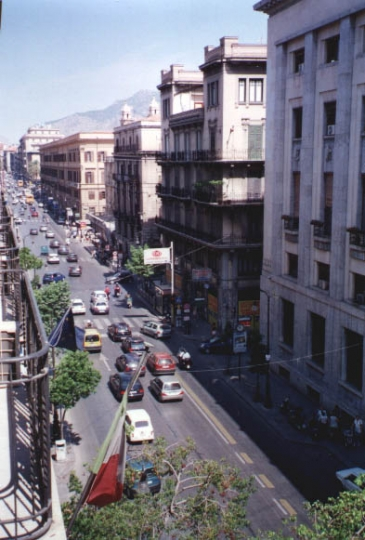 The same street today, noisy, filthy, chaotic and mostly boarded over. Oh, and Cannoli-Free!