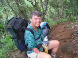 Marie-Belle at about 3 mile point on the trail. Tired but still smiling because of the fantastic views lush forest and the trail is easy here.However you benefit from good hiking boots and hiking poles. MB only needs one pole since she only has one f