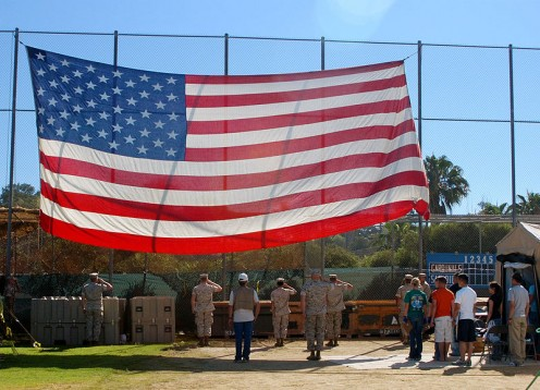 The Military, Civilians and Homeless salute the U.S. Flag, during stand down for homeless veterans.